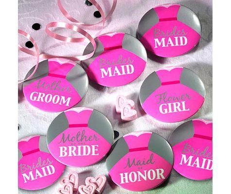 chapas para boda en color rosa con mensajes de los novios