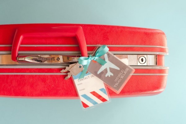 Identificadores para maleta personalizada adornados con lazo