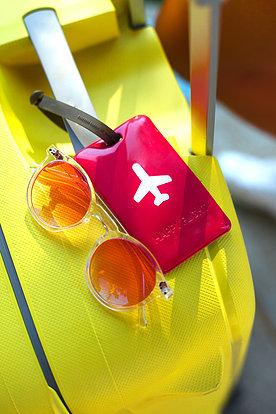 Identificador para maletas rojo de PVC con dibujo de avión