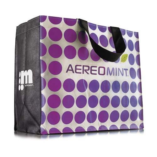 Bolsa de la compra personalizada con fondo blanco, lunares morados y personalizada con logo